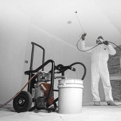 Elite 3000 sprayer and guy spraying ceiling